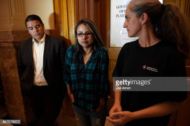 Ingrid Encalada Latorre speaks to the press through translator Jennifer Piper of the American Friends Service Committee after learning that Gov John...