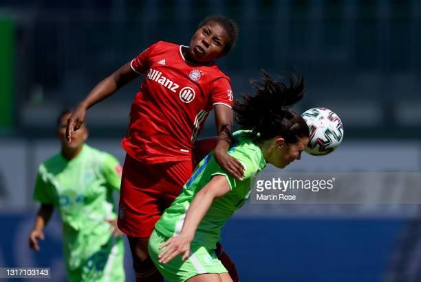 Ingrid Engen of VfL Wolfsburg challenges Lineth Beerensteyn of FC Bayern München during the FLYERALARM Frauen Bundesliga match between VfL Wolfsburg...