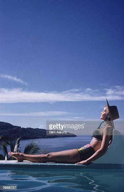 Ingrid Morath sunbathes by a swimming pool next to the sea in Acapulco 1961 Ingrid was born in Rio de Janeiro and lives in Mexico City