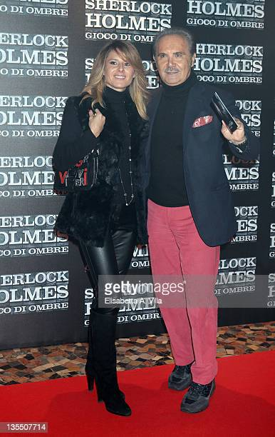 Ingrid Muccitelli and Mauro Masi attend 'Sherlock Holmes: Games Of Shadows' Premiere at The Space Moderno Cinema on December 11, 2011 in Rome, Italy.