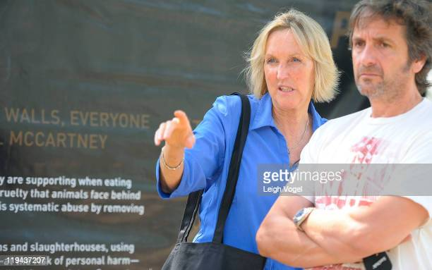 Ingrid Newkirk and Riccardo Savi attend the PETA Glass Walls Exhibit at the National Mall on July 20 2011 in Washington DC