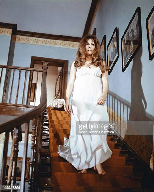 Ingrid Pitt Polish actress wearing a long white dress walking down a staircase in a publicity still issued for the film 'The Vampire Lovers' United...