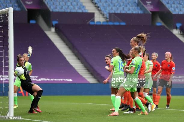 Ingrid Syrstad Engen of VfL Wolfsburg scores her team's second goal during the UEFA Women's Champions League Quarter Final between Glasgow City Women...