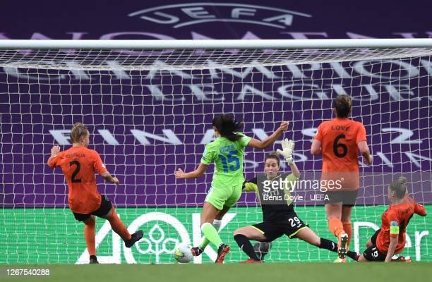 Ingrid Syrstad Engen of VfL Wolfsburg scores her team's third goal during the UEFA Women's Champions League Quarter Final between Glasgow City Women...