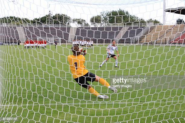 Ingrid Thorbjornsen of Norway stops a penalty shoot of Selina Wagner of Germany during the Women's U19 European Championship match between Germany...