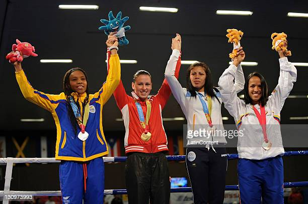 Ingrid Valencia of Colombia Mandy Bujold of Canada Paola Benavides of Argentina and Karlha Magliocco of Venezuela celebrate their medals at the...