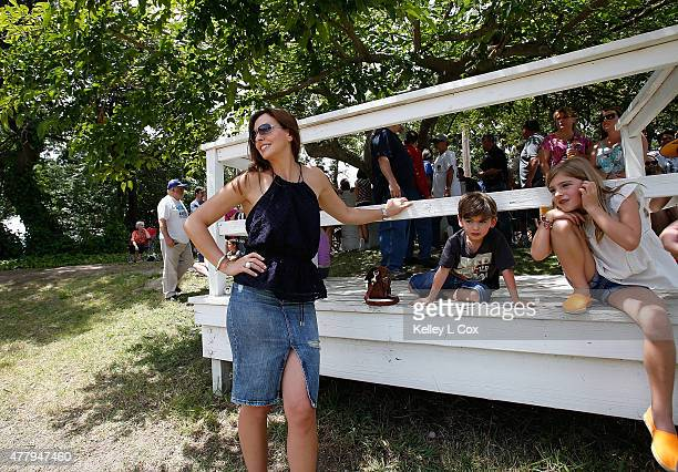 Ingrid Vandebosch and children Leo Gordon and Ella Gordon watch the races at the Capitol Quarter Midget Association Dirt Track on June 20 2015 in Rio...