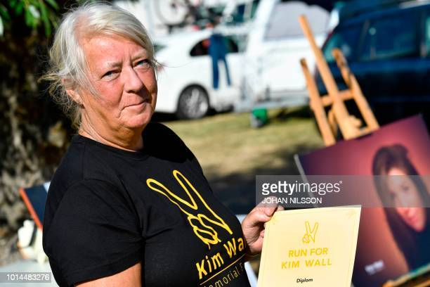 Ingrid Wall the mother of murdered Swedish journalist Kim Wall poses with a diploma that all participants of the Run for Kim charity run will receive...