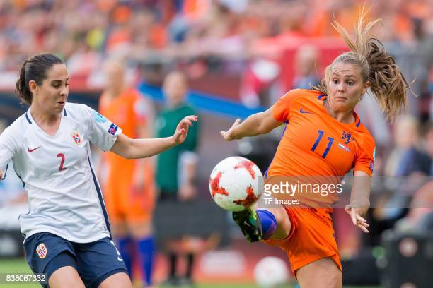 Ingrid Wold of Norway and Lieke Martens of the Netherlands battle for the ball during their Group A match between Netherlands and Norway during the...