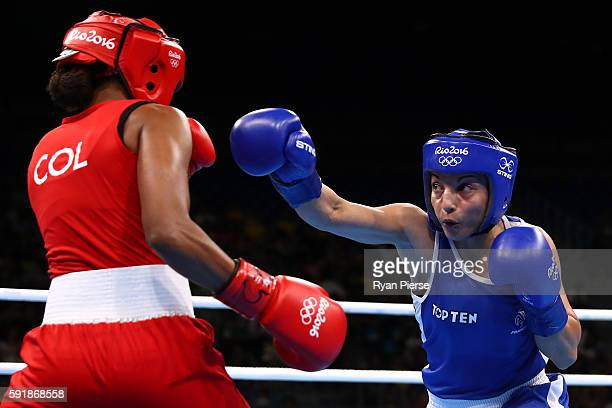 Ingrit Lorena Valencia Victoria of Colombia fights against Sarah Ourahmoune of France during a Women's Fly Semifinal bout on Day 13 of the 2016 Rio...