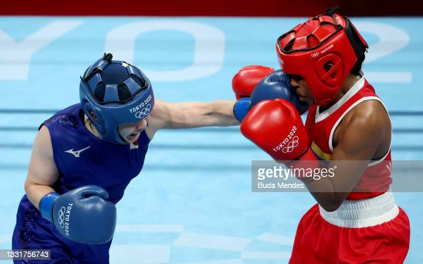 Ingrit Lorena Valencia Victoria of Team Colombia exchanges punches with Tsukimi Namiki of Team Japan during the Women's Fly quarter final on day nine...