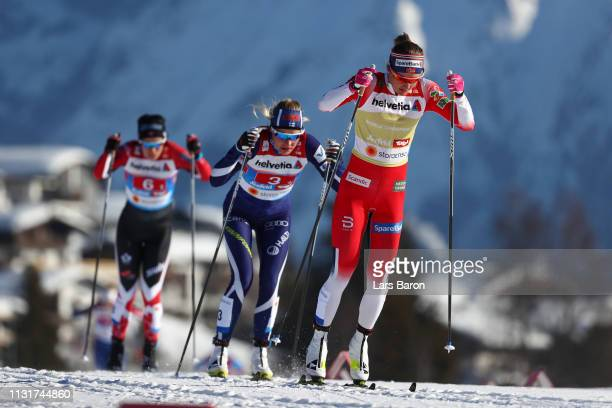 Ingvild Flugstad Oestberg of Norway and Anne Kylloenen of Finland compete in the first semifinal run for the Ladies' Cross Country Team Sprint during...