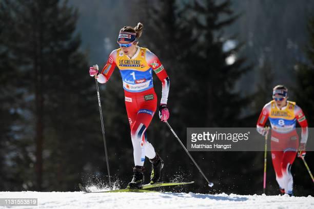 Ingvild Flugstad Oestberg of Norway and Astrid Uhrenholdt Jacobsen of Norway compete in the Cross Country Skiathlon Ladies 15k race during FIS Nordic...