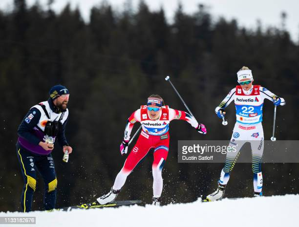 Ingvild Flugstad Oestberg of Norway and Frida Karlsson of Sweden compete in the Women's 30km Cross Country mass start during the FIS Nordic World Ski...
