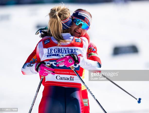 Ingvild Flugstad Oestberg of Norway and Therese Johaug of Norway hug in the finish area after the Women's 10km freestyle pursuit during the FIS Cross...