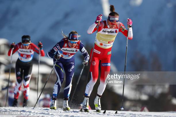 Ingvild Flugstad Oestberg of Norway Anne Kylloenen of Finland and Emily Nishikawa of Canada compete in the first semifinal run for the Ladies' Cross...
