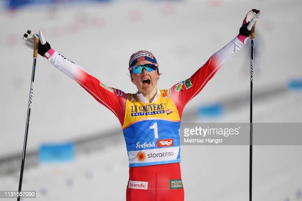 Ingvild Flugstad Oestberg of Norway celebrates as she crosses the finish line for second place in the Cross Country Skiathlon Ladies 15k race during...