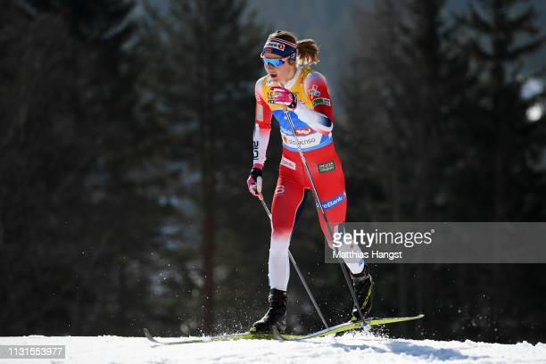 Ingvild Flugstad Oestberg of Norway competes in the Cross Country Skiathlon Ladies 15k race during FIS Nordic World Ski Championships on February 23...