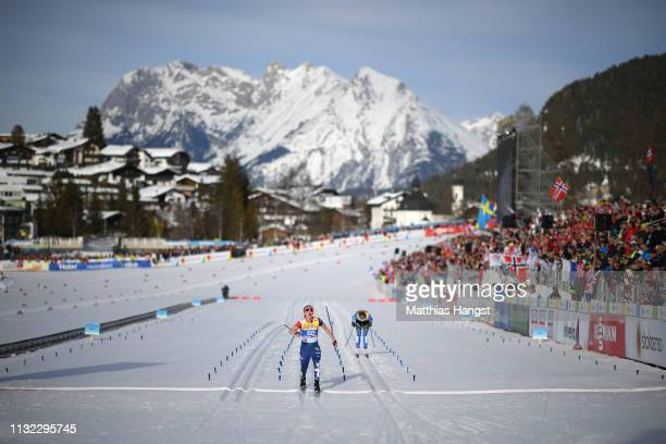 Ingvild Flugstad Oestberg of Norway crosses the finish line during the CrossCountry Women's 10k race of the FIS Nordic World Ski Championships at...