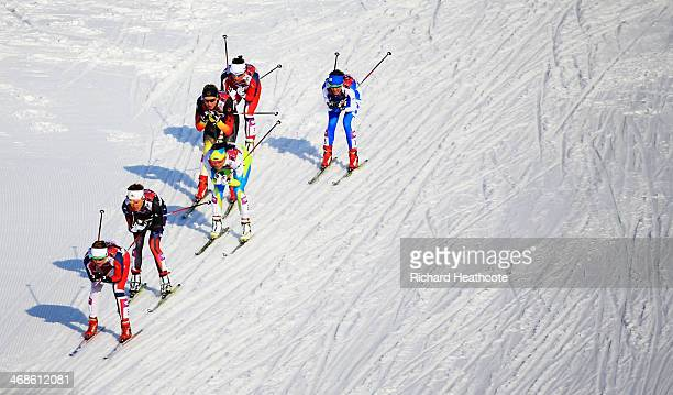 Ingvild Flugstad Oestberg of Norway leads the pack in Finals of the Ladies' Sprint Free during day four of the Sochi 2014 Winter Olympics at Laura...