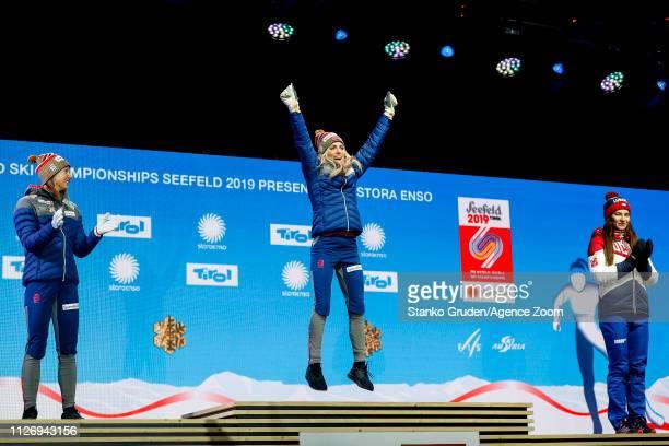 Ingvild Flugstad Oestberg of Norway takes 2nd place, Therese Johaug of Norway takes 1st place, Natalia Nepryaeva of Russia takes 3rd place during the...