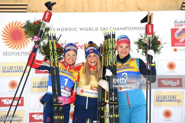 Ingvild Flugstad Oestberg of Norway Therese Johaug of Norway and Natalia Nepryaeva of Russia celebrates on the podium following the Cross Country...