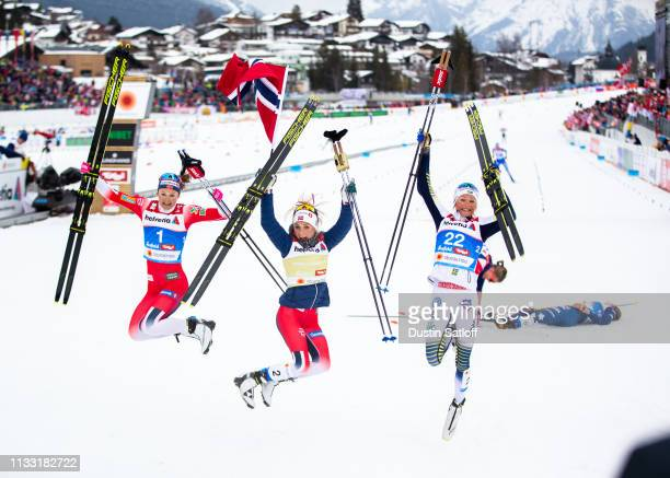 Ingvild Flugstad Oestberg of Norway Therese Johaug of Norway and Frida Karlsson of Sweden pose in the finish area after the Women's 30km Cross...