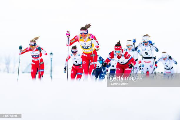 Ingvild Flugstad Oestberg of Norway Therese Johaug of Norway Frida Karlsson of Sweden compete in the Women's 10km classic mass start during the FIS...
