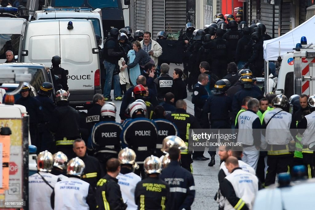 Inhabitants are evacuated from a security perimeter set in the northern Paris suburb of Saint-Denis city center, on November 18, 2015, as French Police special forces raid an appartment, hunting those behind the attacks that claimed 129 lives in the French capital five days ago. At least one person was killed in an apartment targeted in the operation aimed at the suspected mastermind of the attacks, Belgian Abdelhamid Abaaoud, and police had been wounded in the shootout.