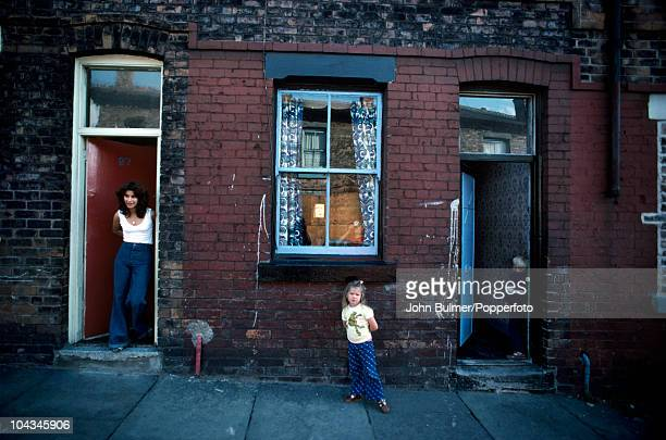 Inhabitants of a terraced street in Manchester England in 1976
