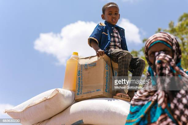Inhabitants of a village in the Somali region in Ethiopia where Pastorale settled because of the persistent drought Here a small boy sits on food...
