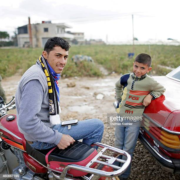 Inhabitants of an informal tented settlement of Syrian refugees on December 09 2014 in Zahle Lebanon The ongoing civil war in Syria continues to...