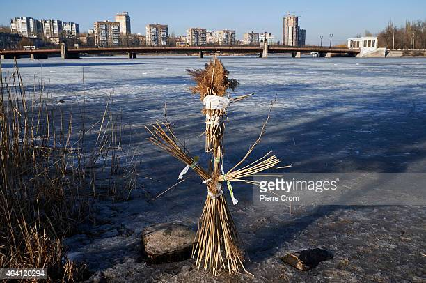 Inhabitants of Donetsk prepare to burna doll made of straw to celebrate the upcoming Spring equinox on February 22 2015 in Donetsk Ukraine Despite a...