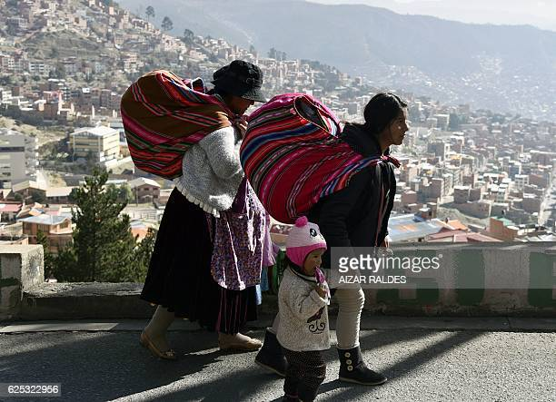 Inhabitants of El Alto march down to La Paz to protest for the shortage of water in both cities, on November 23, 2016 in La Paz. Bolivia suffers its...