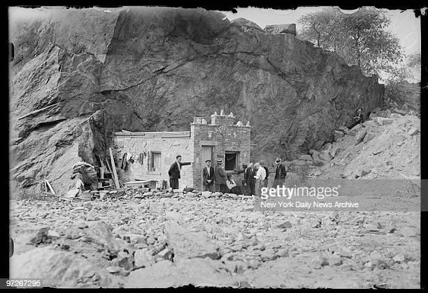 Inhabitants of Hooverville gather outside the Mansion town's chief edifice which snuggles in lee of rocky cliff to protect it from wintry winds