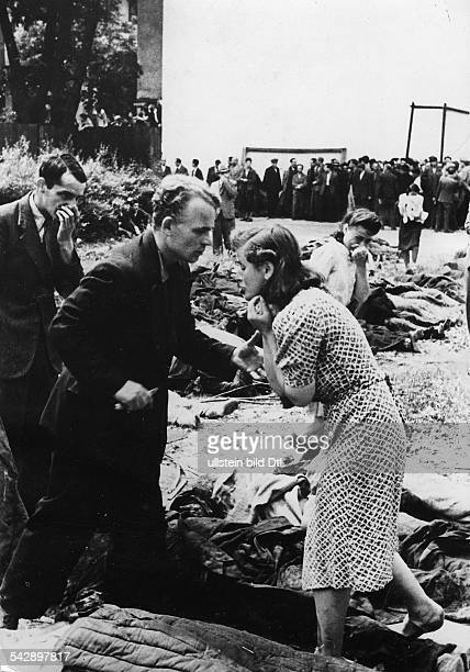 WW II Inhabitants of Lwow/Lviv among corpses tyrying to identify members of their families who got killed by the GPU June 1941 Photographer...