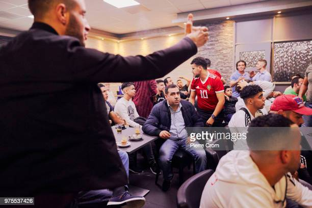 Inhabitants of Schilderswijk a neighborhood in The Hague with a DutchMoroccan community watch the Moroccan national footbal team as they play Iran in...