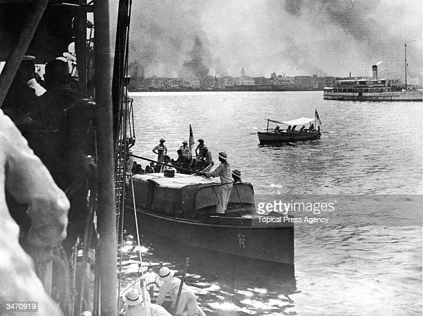 Inhabitants of Smyrna escape by boat after the city is attacked by Turkish forces under Mustapha Kemal Ataturk September 1922