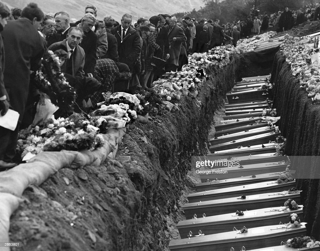 Inhabitants of the Welsh mining village of Aberfan attend the mass funeral for 81 of the 190 children and adults who perished when a landslide engulfed the junior school.