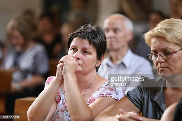 Inhabitants prays in local church in Vrpolje on August 12 after hearing in the news that Islamic State group claims to have beheaded Croatian hostage...