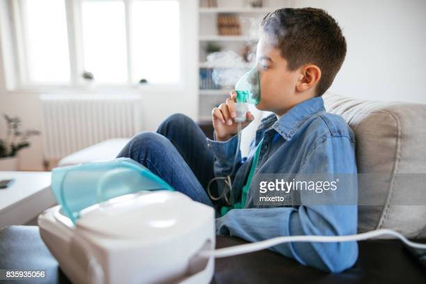 inhalating at home - asthmatic stock photos and pictures