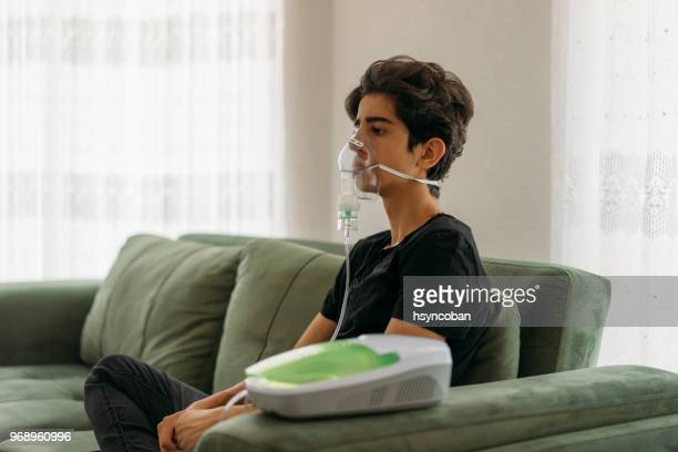 inhalating at home - chronic illness stock photos and pictures