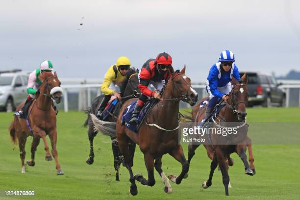 Inhaler with jockey BA Curtis battle with Mutazawwed and Jim Crowley on Epsom Downs south of London on July 4 2020 during the Invested Woodcote EBF...