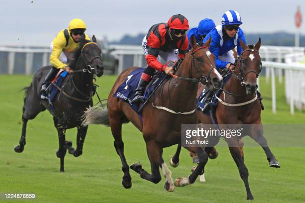 Inhaler with jockey BA Curtis lead Mutazawwed and Twaasol on Epsom Downs south of London on July 4 2020 during the Invested Woodcote EBF Stakes and...