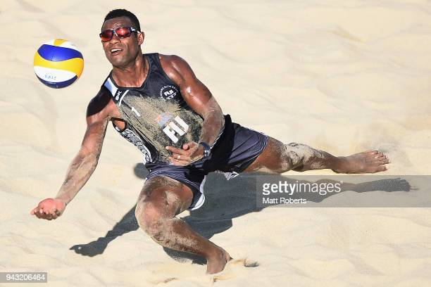 Inia Korowale of Fiji competes during the Beach Volleyball Men's Preliminary round against Daynte Stewart and Daneil Williams of Trinidad and Tobago...