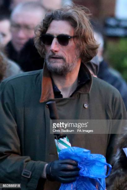 iNick Reynolds son of Bruce Reynolds attends the funeral of Ronnie Biggs at Golders Green Crematorium in North London