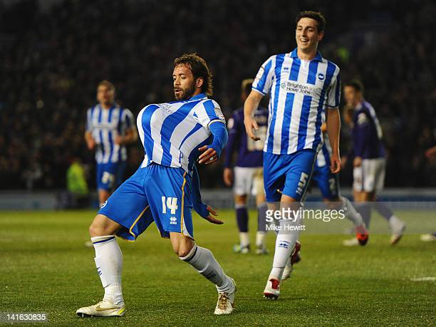 Inigo Calderon of Brighton celebrates for his pregnant girlfriend after opening the scoring with team mate Lewis Dunk during the npower Championship...