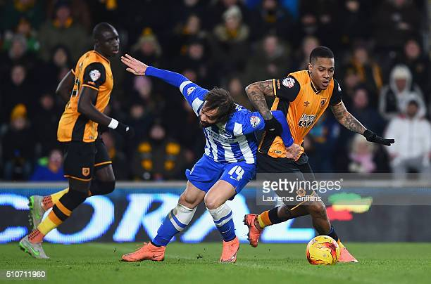 Inigo Calderon of Hull City battles with Abel Hernandez of Brighton and Hove Albionduring the Sky Bet Championship match between Hull City and...
