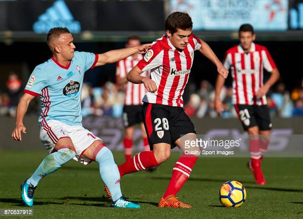 Inigo Cordoba of Athletic de Bilbao is challenged by Stanislav Lobotka of Celta de Vigo during the La Liga match between Celta de Vigo and Athletic...