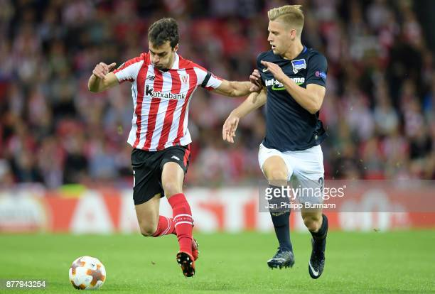 Inigo Lekue of Athletic Bilbao and Arne Maier of Hertha BSC during the UEFA Europe League Group J match between Athletic Bilbao and Hertha BSC at San...